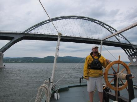 Tom Larsen guides the boat underneath the Champlain Bridge.
