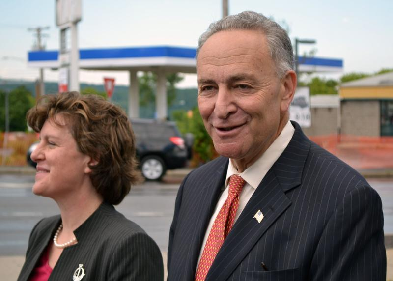 Sen. Charles Schumer walks with Syracuse Mayor Stephanie Miner. (File photo)