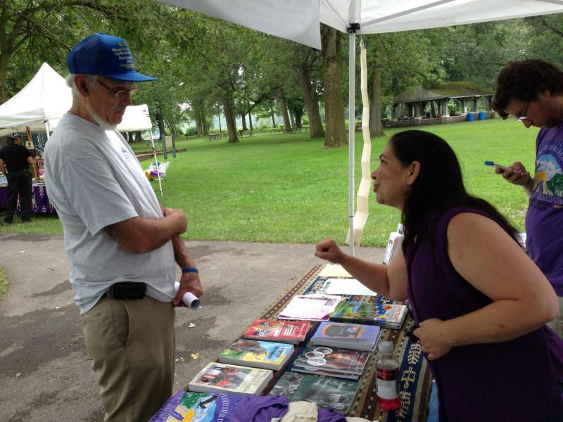 Allison Smith speaks to visitors to the Two Row Wampum Festival at Onondaga Lake Park Tuesday.