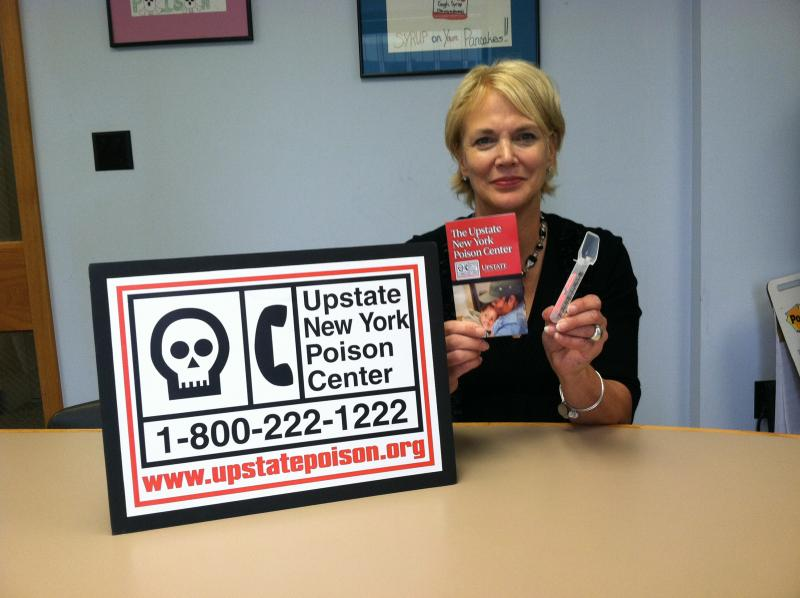Upstate Poison Center Communication Director Gail Banach shows the Operation Medicine Spoon handouts