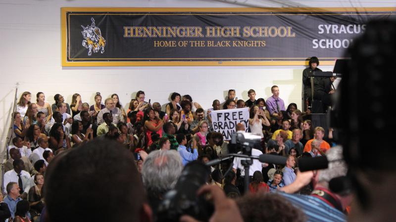 Two protesters are removed from the Henninger High School gym after interrupting the president's speech, calling on the president to release Bradley Manning. Manning was sentenced to 35 years in prison for leaking classified documents to Wikileaks