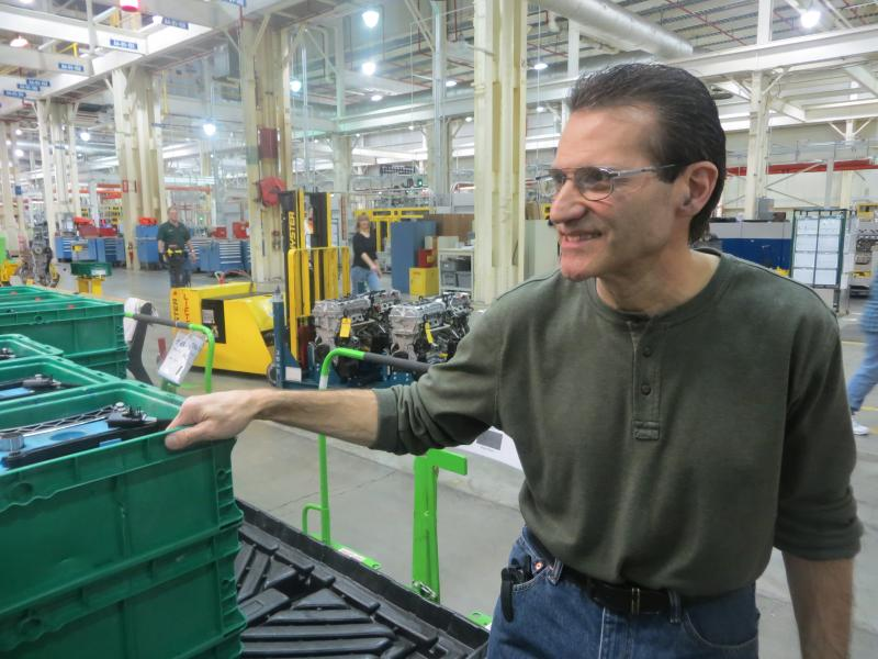 Joe Frontera stands on the factory floor.