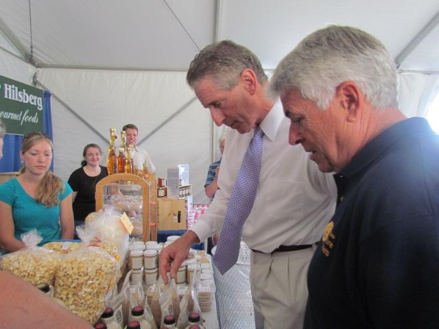 Lt. Gov. Robert Duffy tries food while inside the Taste NY tent.