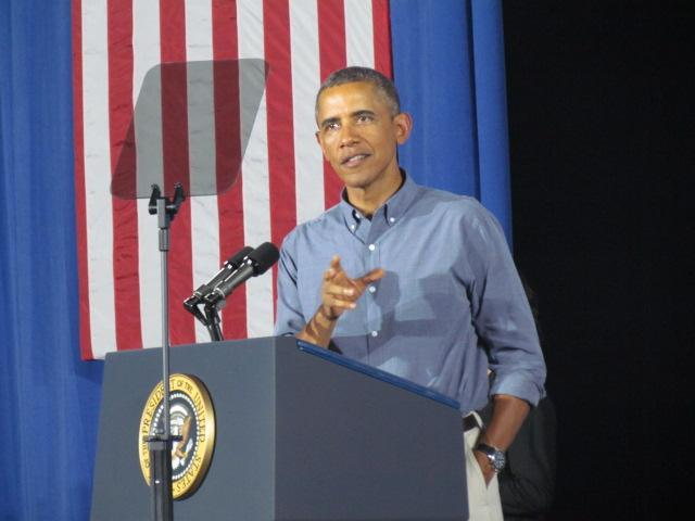 President Obama speaks to the crowd at Henninger High School in Syracuse