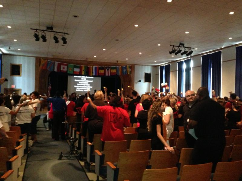 Teachers hold a rally during the iZone kick-off event at Porter Elementary School.