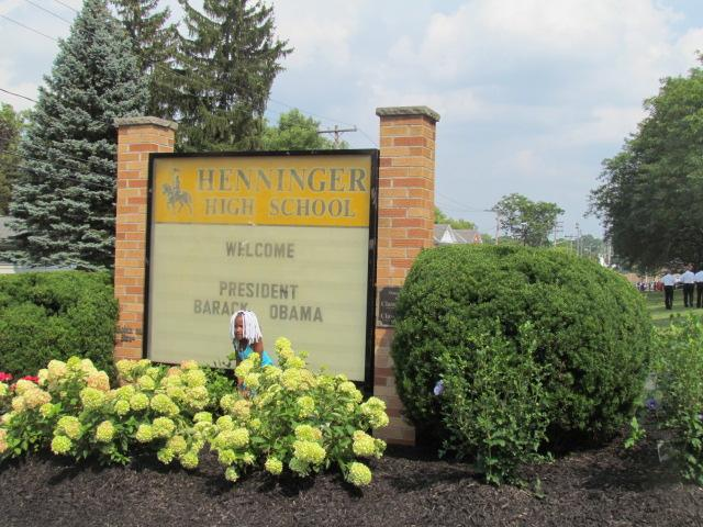 Some who did not have tickets to the event at Henninger High School took pictures to commemorate the event.