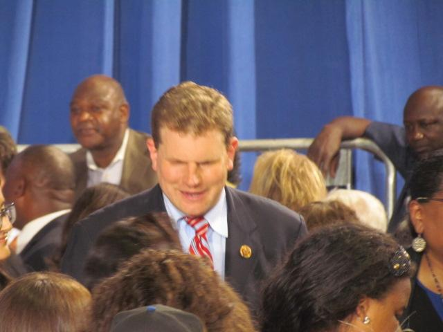Congressman Dan Maffei talks to a group of people before President Obama's speech at Henninger High School in Syracuse on Thursday.