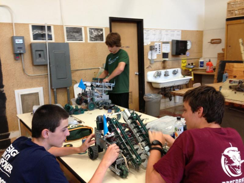 Students work in teams to make their robots for the competition