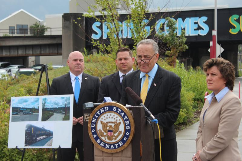 Senator Schumer was in Syracuse to discuss DOT-111 railcars. L to R: Commissioner of Emergency Management for Onondaga County, Kevin Wisely.  Chairman of the Onondaga County legislature, Ryan McMahon. Senator Charles Schumer. Mayor Stephanie Miner.