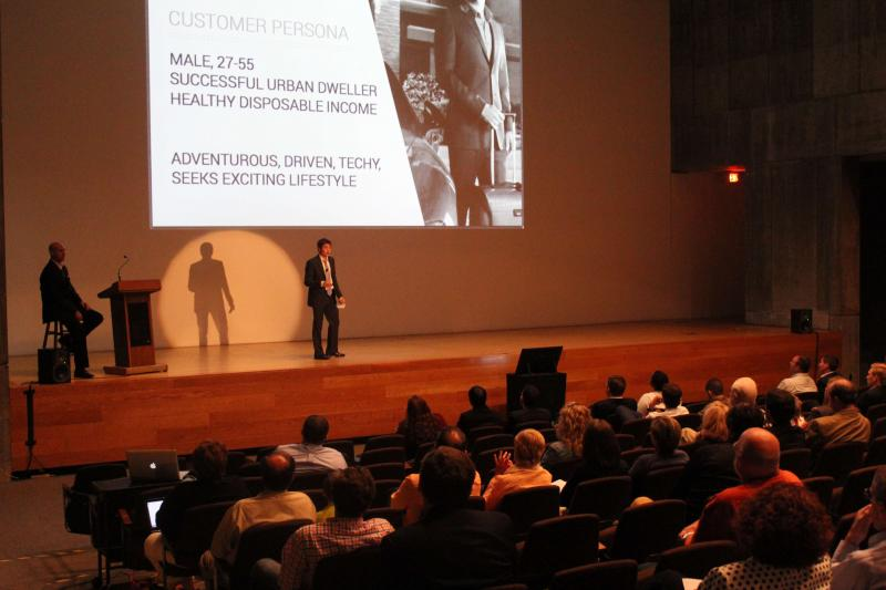 Anthony DiMare gives his company, Regattable, sales pitch to potential investors at the 2013 Syracuse Student Sandbox Demo Day in the Hosmer Auditorium at the Everson Museum.
