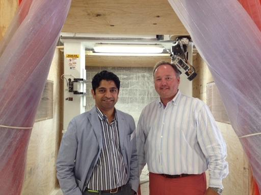 Omar Kahn and Bill Pottle standing in front of the 5-axis router.