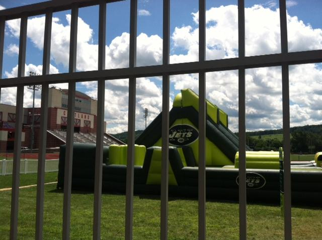 A shot of a bouncy obstacle course from outside the gate at SUNY Cortland.