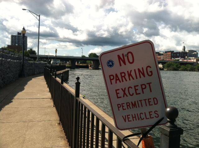 A sign warns certain boaters not to park in the area.