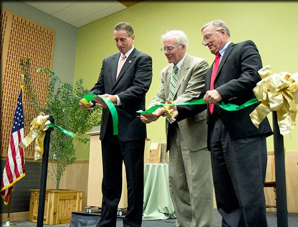 SUNY ESF president Neil Murphy, Lt. Gov. Robert Duffy, and State Senator John Defransisco cut the ribbon on the new welcoming center.