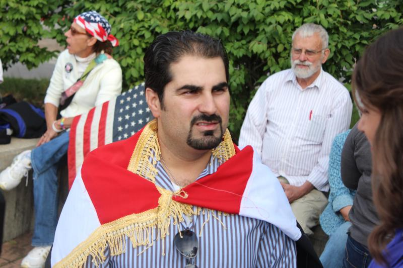 Jeurje Alamir speaks during a peace vigil for Syria in Syracuse.