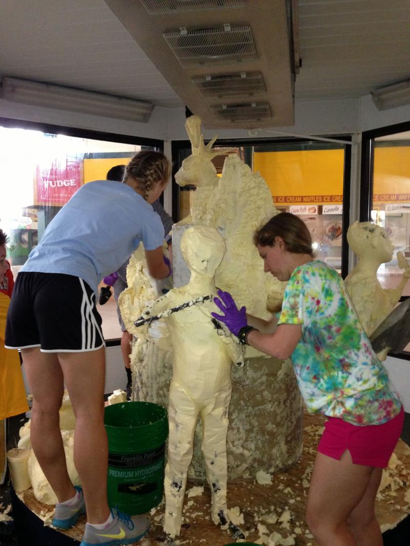 SUNY ESF students turn the butter sculpture into butter chips.