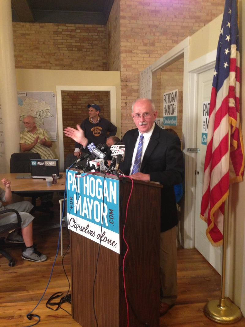 Pat Hogan stands behind the podium to speak following the primary vote.
