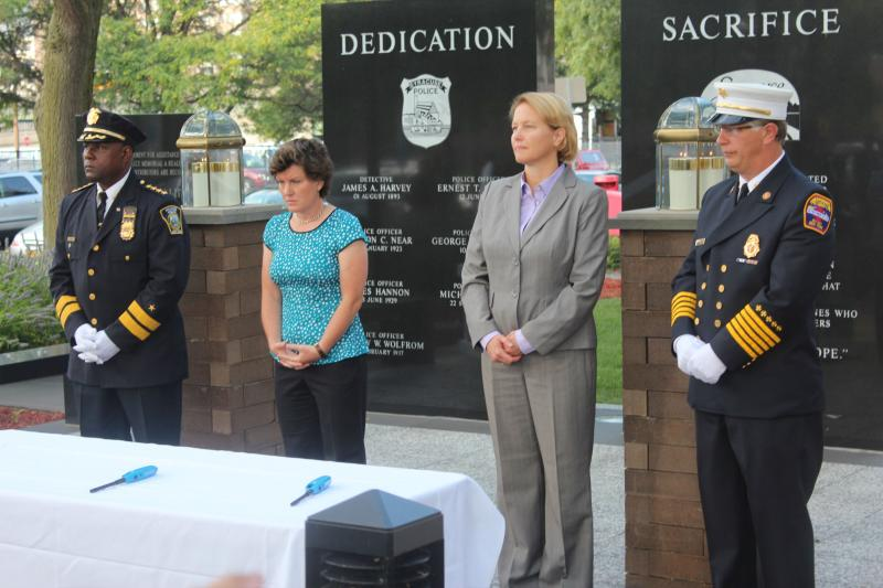 From l-r Syracuse Police Chief Frank Fowler, Syracuse Mayor Stephanie Miner, Onondaga County Executive Joanie Mahoney, and Syracuse Fire Chief Paul Linnertz mark the 12th anniversary of 9/11 in a ceremony in downtown Syracuse