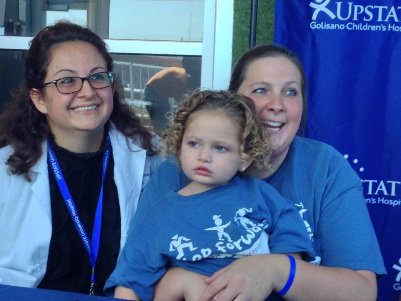 Dr. Zulma Tovar-Spinoza with two-year-old Arianna Failla and her mother, Jennifer Failla.