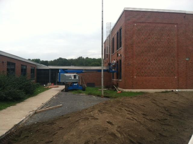 Work continues on the outside of the former Altmar Elementary School, as it prepares to reopen as the Tailwater Lodge.