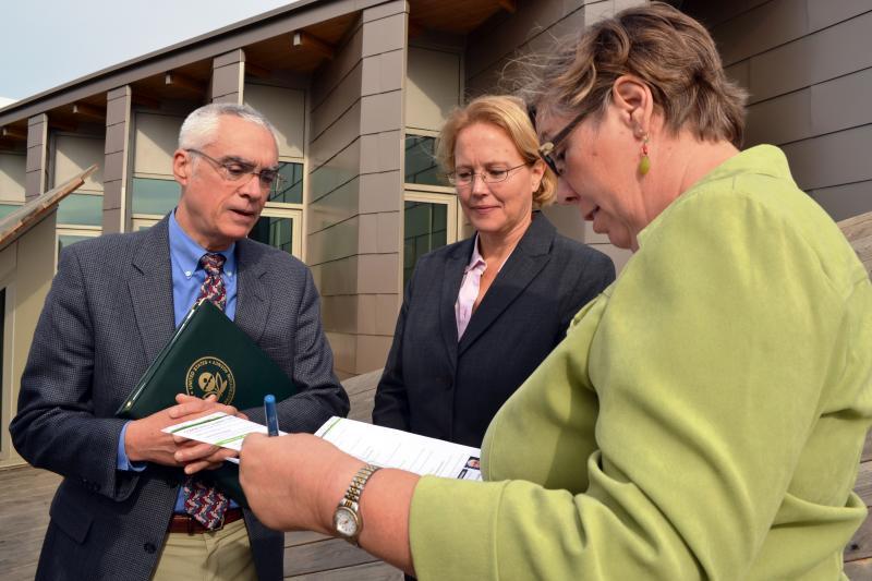 Environmental Protection Agency Deputy Administrator Bob Perciasepe, left, talks with Onondaga County Executive Joanie Mahoney and EPA Regional Administrator Judith Enck.