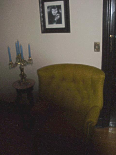 Unexplained shadow in one of the guest bedrooms. When the photo was lightened, the entire chair, side table and floor were clearly visible.