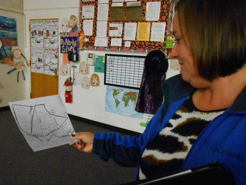 Carol Molinari holds a map outlining what she thinks should be the geographic boundaries of the study. Molinari requested the study, suspicious that her two sons' birth defects could have been caused by pollution from the Air Brake plant.