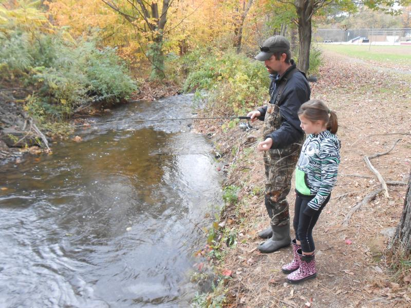 Jose Fernandez has been teaching his daughter Olivia, 7, how to fish, during this year's salmon spawning season.