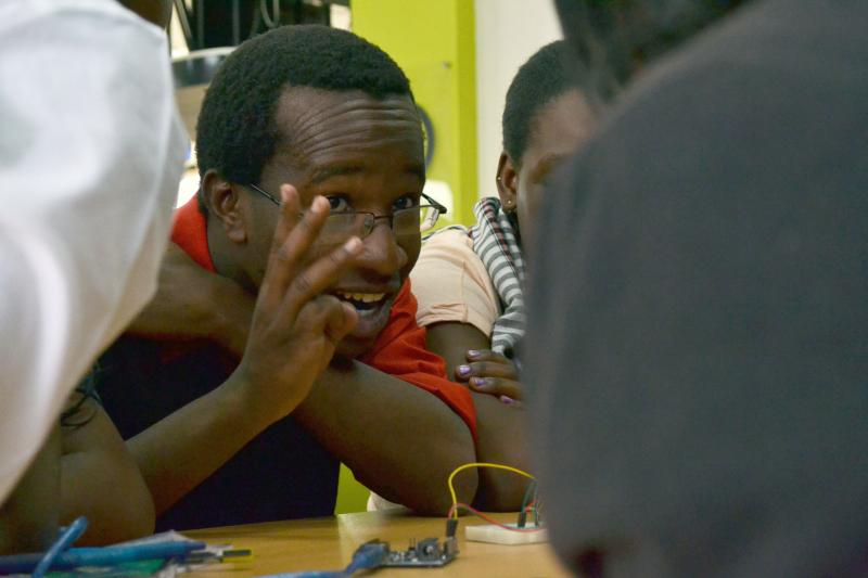 A counselor gives instructions during a kids hackers camp at the iHub tech incubator in Nairobi.