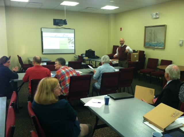 A small group attends an Energy Challenge meeting in Oswego.