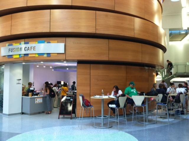 Students talk and get food near the Fusion Cafe inside SUNY Oswego's new Shineman Center.