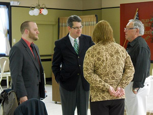 City Council candidates Cody Horbacz and Stephen Jennings talk with Jefferson County Democratic Party Chairman Ron Cole and Jefferson County Legislature candidate Donna Bohn after the meet-the-candidates luncheon.