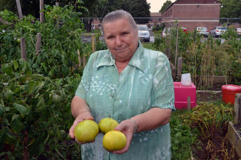 Stepanda Zhushma in a community garden in Utica. She came to upstate New York from Belarus on Sept. 23, 1989, a date that rolls off her tongue.