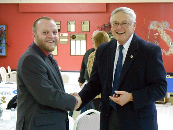 City Council candidate Cody Horbacz, left, and Lewis County GOP officer Timothy O'Connor, strike politicians' poses after the meet-the-candidates luncheon at the Italian-American Civic Association in Watertown.