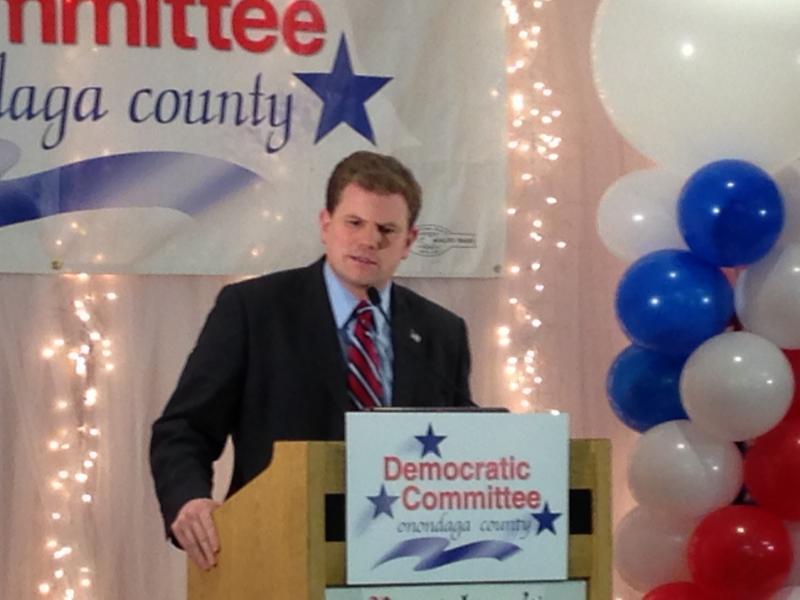 Rep. Dan Maffei speaks at the podium during the Democratic Party's election night event.