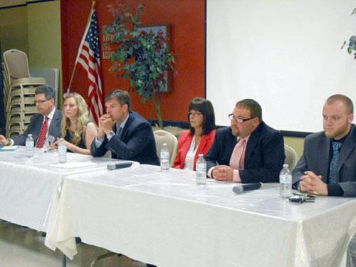 Incumbent Jeff Smith, third from left, listens to a question during a meet-the-candidates event before the City Council primary.
