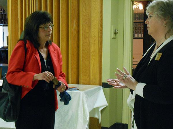 Incumbent Teresa Macaluso, left, chats with Lisa L'Huillier, an officer with the women's Realtors group that sponsors a final meet-the-candidates event every year.