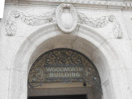 An old doorway tells the Woolworth building's history.