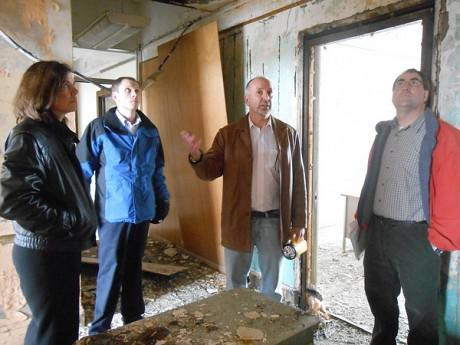 Developer Erich Seber gives local officials a tour of the Woolworth building in downtown Watertown, in April.