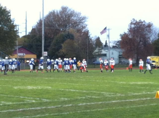 Oswego's football team competes against Nottingham during the Oswego's final regular season game.