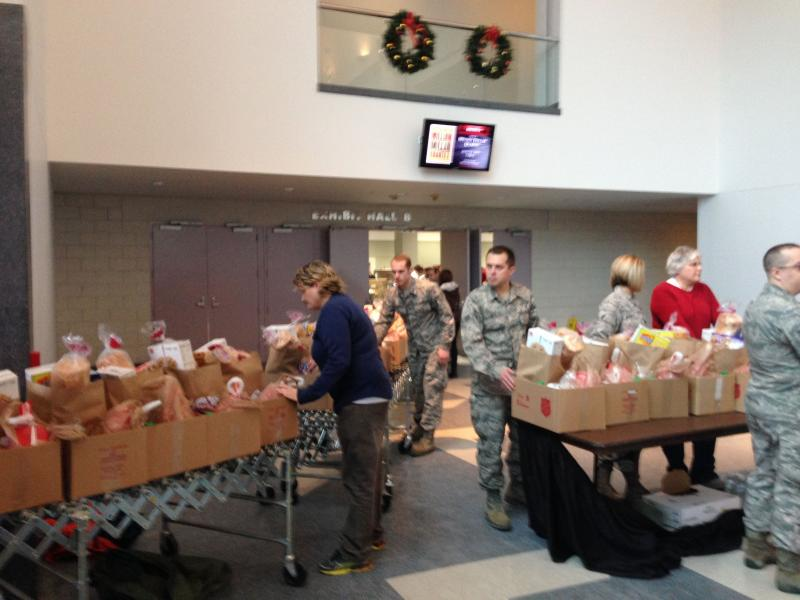 Members of the 174th Air National Guard Attack Wing help with food distribution