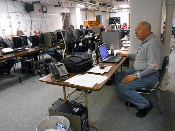 Bob Simpson, Jefferson County deputy fire coordinator, manages the county's Emergency Operations Center during the storm.