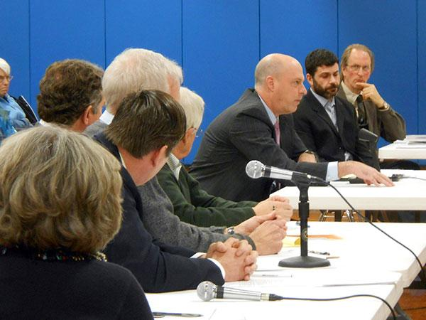 Officials from Cape Vincent and the state Public Service Commission listen as BP attorney John Harris addresses state regulators.