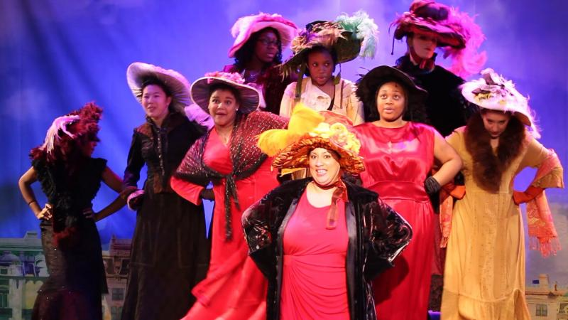 "Tamar Smithers (Center, big yellow hat) plays Eulalie Mackecknie Shinn in ""The Music Man"" and is an education coordinator at the Community Folk Art Center in Syracuse."
