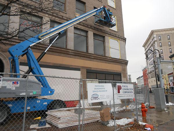 Asbestos abatement is the first step toward transforming the vacant Woolworth building into apartments and businesses.
