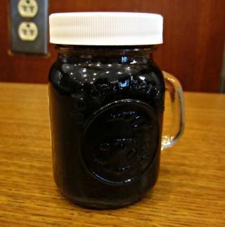 Sample jar of beet juice extract