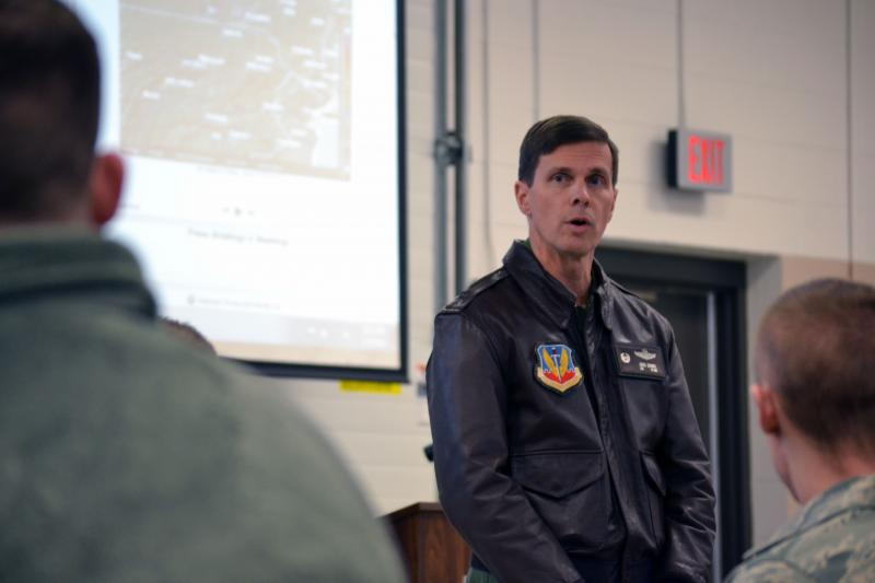 Col. Greg Semmel, commander of the 174th Attack Wing of the Air National Guard, briefs guard members before going out to help with the winter storm.