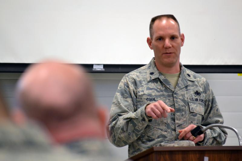 Lt. Col. Edward Cook, Readiness Squadron Commander in the 174th Attack Wing, briefs guard members before going out to help with the winter storm.