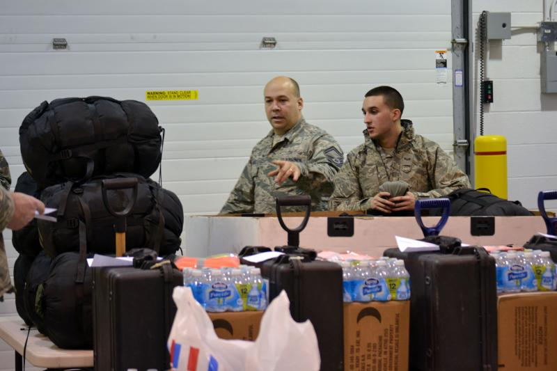 Members of the 174th Air National Guard Attack Wing prepare supplies to help western New York residents after the blizzard.