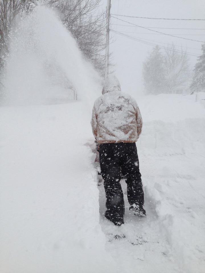 Residents in Adams move snow following storms that hit the area earlier this week.
